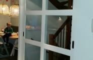 schuifdeuren voor trap opening voorzien van glas