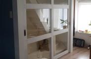 opmaat gemaakte schuifdeuren voor trappengat